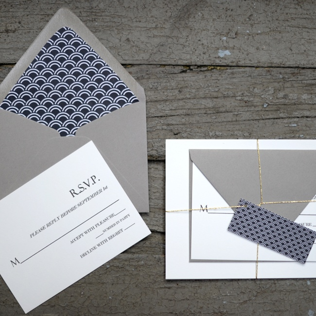 The bride created her own DIY invitation suite with gray envalopes and a navy, patterned liner.