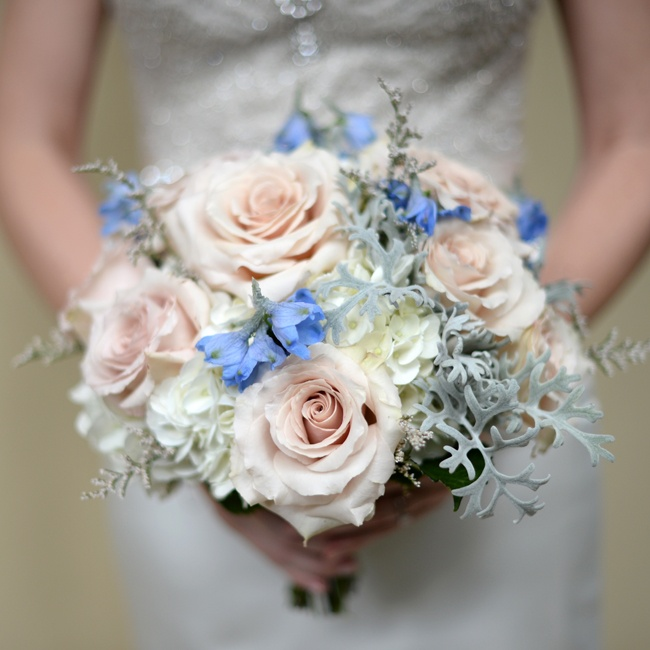 Amanda's bouquet was full of soft pink roses, white hydrangeas and dusty miller leaves.