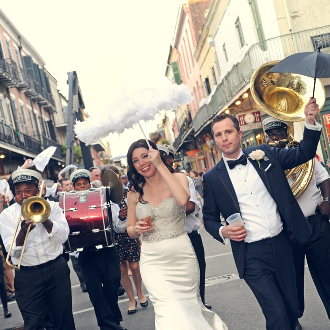 "In New Orleans tradition, the couple obtains a permit for a brass band parade in the streets and anyone who wants to enjoy the music and march in line after them forms the ""second line."""