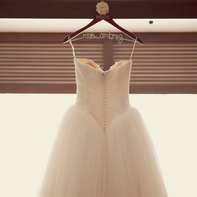 Stephanie looked like a princess in an ivory Vera Wang ball gown with a sweetheart neckline. The gown featured Chantilly lace applique lace at the bodice, a basque waistline and satin button details down the back.