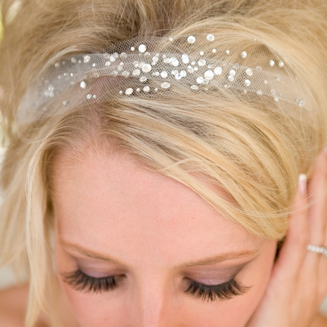 Stephanie accessorized with a rhinestone-studded headband made from light, airy tulle for a touch of glamour.
