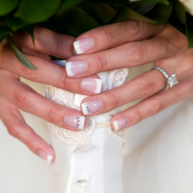 Stephanie bedazzled her classic French manicure to complement her glam look.