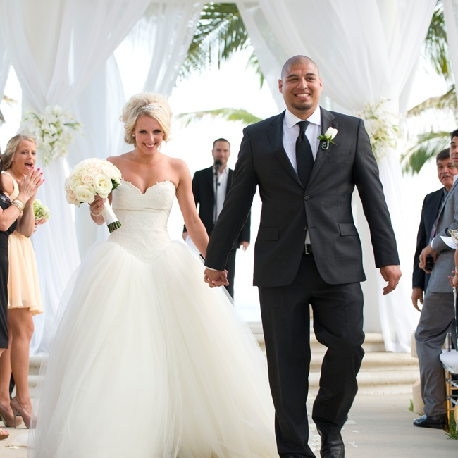Hector proudly walked down the aisle with his beautiful new wife, looking handsome in a black Hugo Boss suit and matching tie.