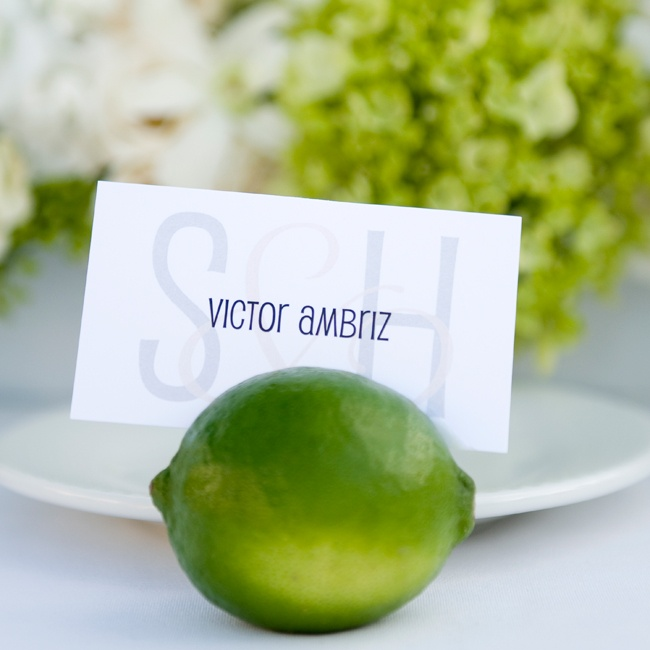 For a fun detail that complemented their scheme, the couple chose limes to hold place cards for each guest.
