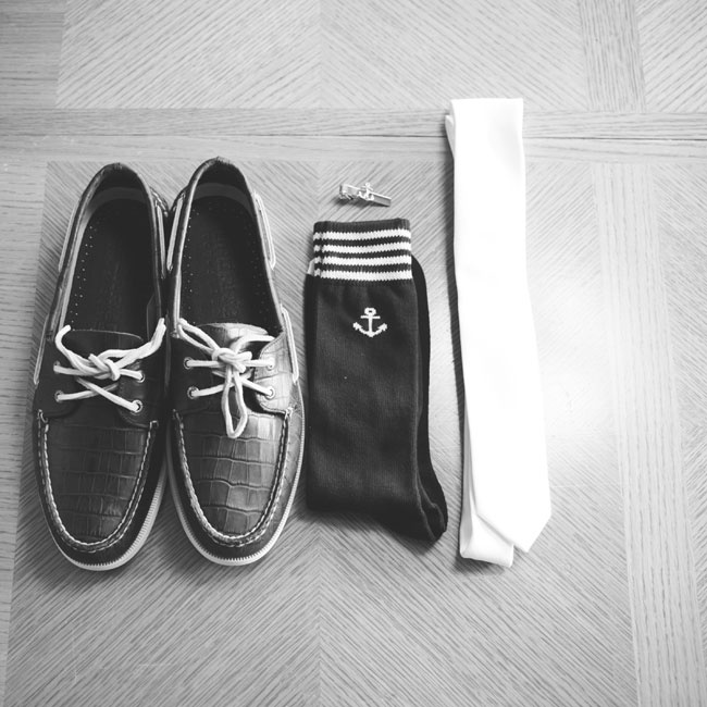 The groomsmen all wore matching anchor tie clips, blue anchor socks and Sperry Topsiders gifted from the couple.
