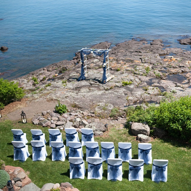 The couple exchanged vows on the rocks outside of a family-owned lighthouse.
