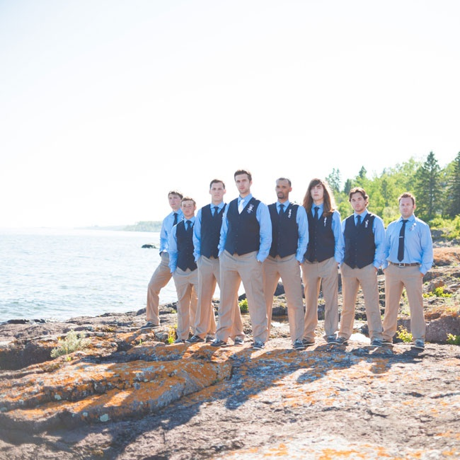 Instead of flowers, the groomsmen wore playful handmade boutonnieres crafted from ribbon, rope and nautical charms.