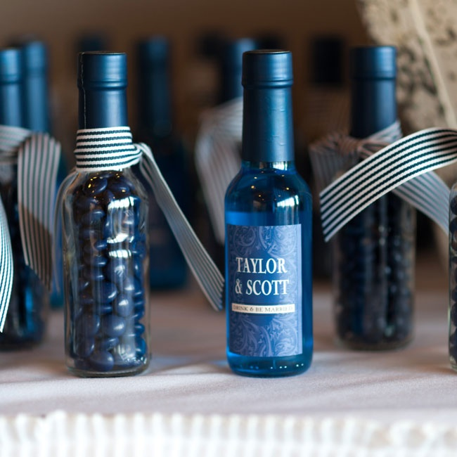 The couple created their DIY favors by mixing blue miniature signature cocktails and also filling some bottles with candy as an alternative to alcohol.