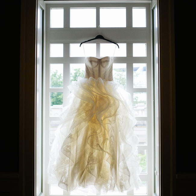 Ronda wore a stunning custom-made Vera Wang gown. The dramatic ballgown featured a structured bodice with lace overlay and a flourish of floating embroidered organza for a romantic and ethereal feel.