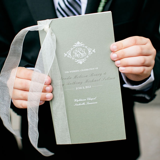 The elegant sage programs featured a decorative ivory monogram and white organdy ribbon.