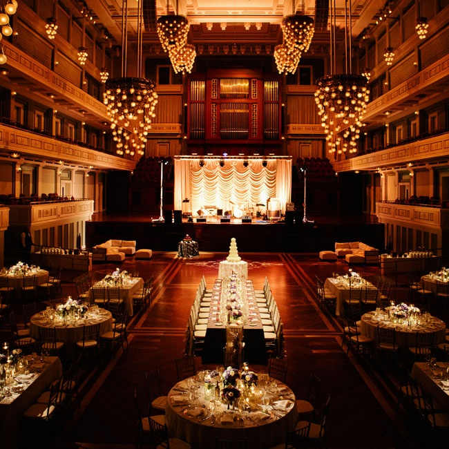 The couple chose the ballroom of the Schermerhorn Symphony Center as the backdrop for their reception. The 60 foot ceilings, exquisitely decorated chandeliers and stunning architecture combined with soft up lighting for a dramatic yet utterly romantic effect. A magnificently lit stage was the perfect setting for a performance by the couple's recept ...