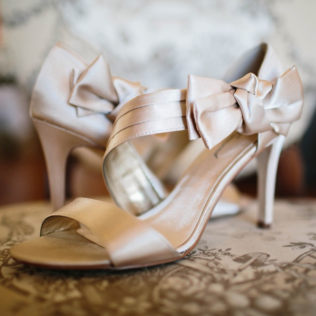 The bride wore Lulu Townsend satin champagne colored heels down the aisle.