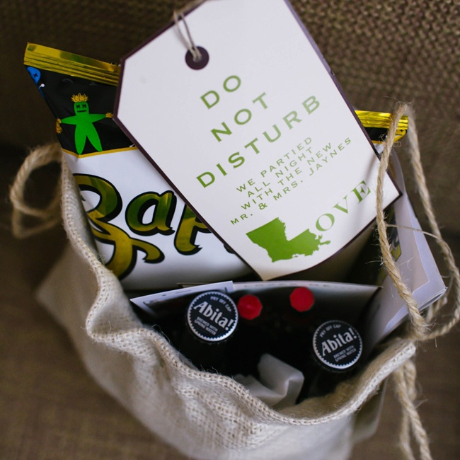 "Guests received welcome bags full of interesting favors including Louisiana themed ""Do not disturb"" cards, hot sauce and chips."