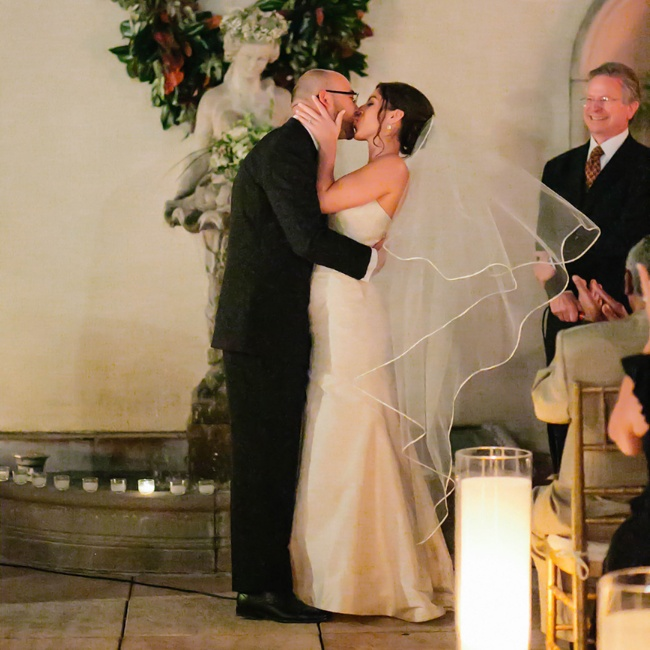 The couple shared their first kiss as newlyweds during the candlelit ceremony at the Ritz-Carlton, New Orleans.