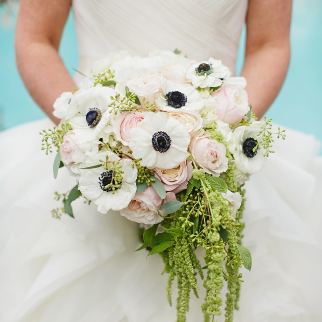 The bride carried this white and black anemone flower bouquet down the aisle.