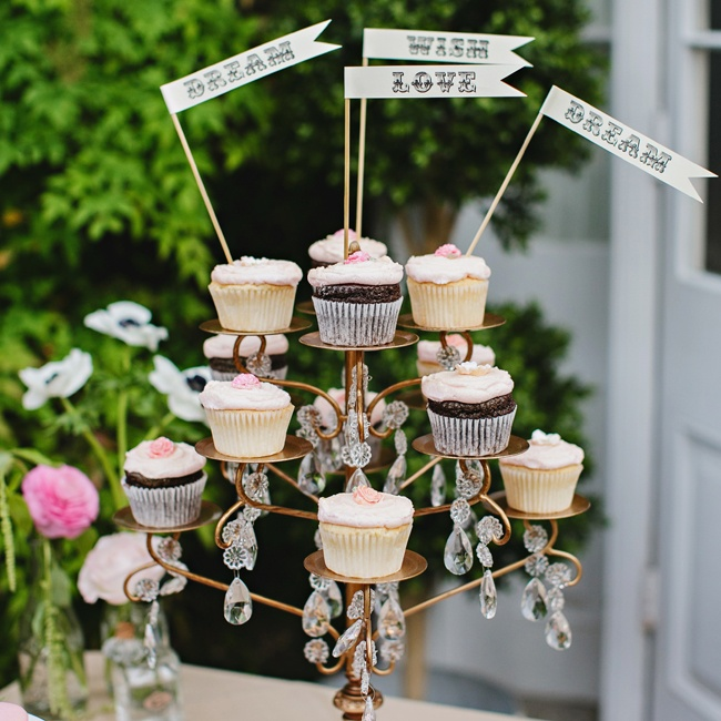 Guests chose from an array of cupcakes on the dessert table for sweets during the reception.