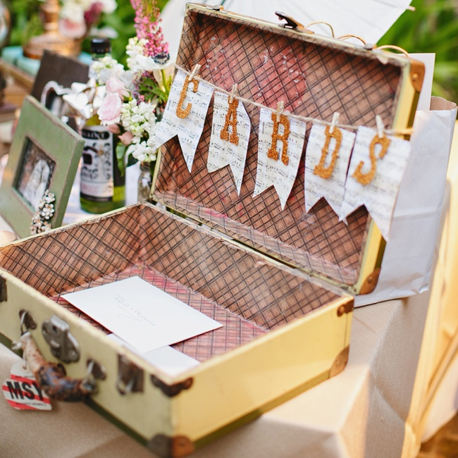 Family and friends placed cards in a vintage-inspired suitcase at the reception.