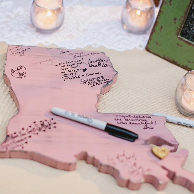 Guests signed their names along with messages for the bride and groom on this pink cut out of Louisiana.