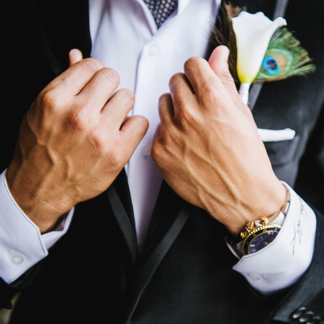 Since Qiana's design aesthetic and color palette was influenced by peacock feathers, it made sense for her groomsmen to have them wrapped in their boutonnieres.