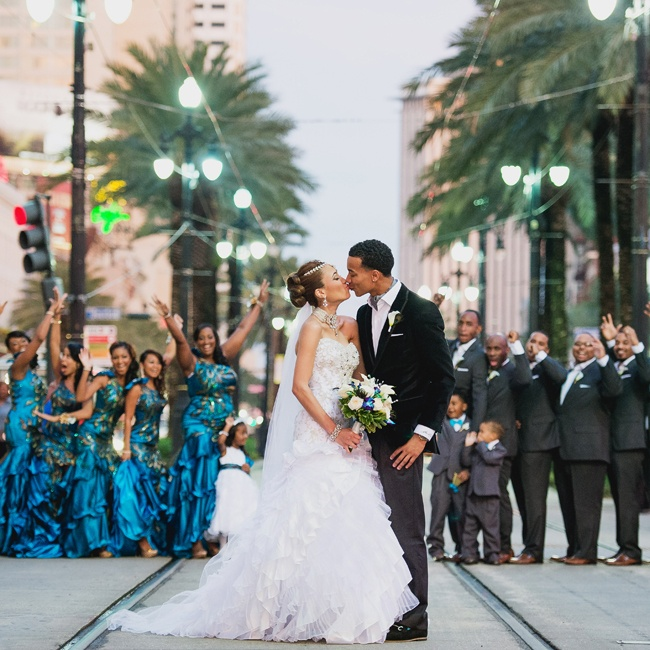 Influenced by peacock feathers, Qiana's bridesmaids wore jewel-toned teal looks down the aisle.