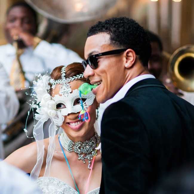The bride wore this white feathered mask in a nod to New Orleans' rich culture.