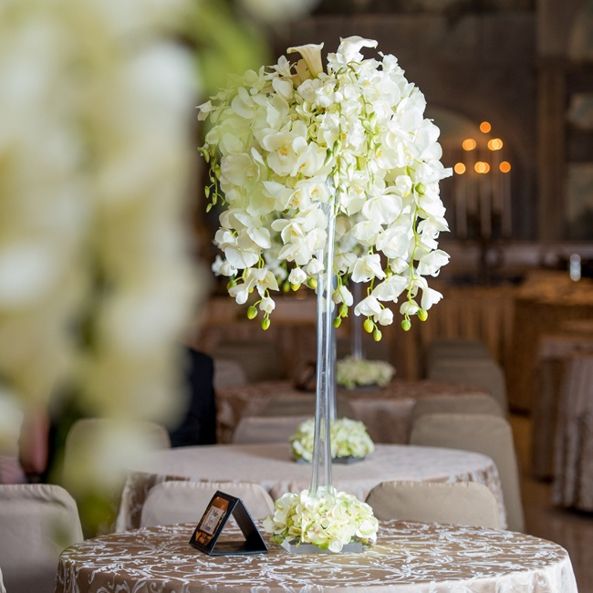 The couple chose high statement-making floral centerpieces full of acacia and calla lilies to decorate the reception space.