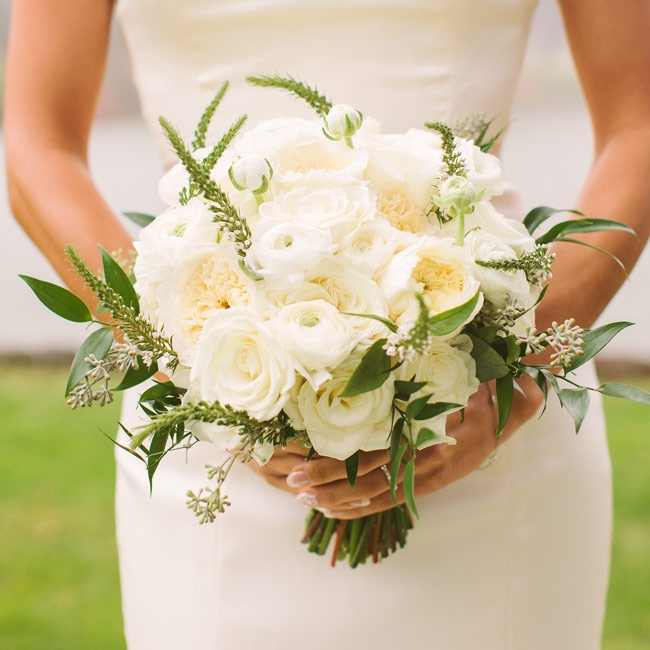 Kyla's bouquet of ivory peonies, roses and astilbe perfectly complemented her elegant bridal look.