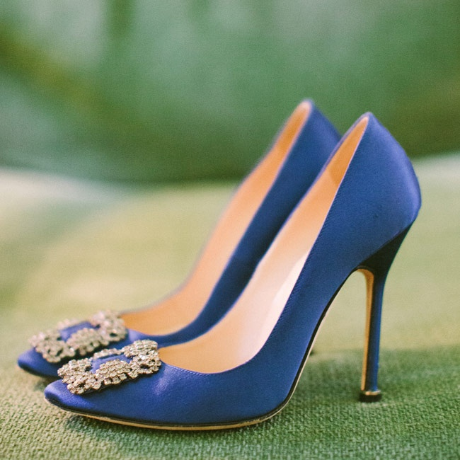 "Kyla tucked a pair of cobalt blue Manolo Blahnik pumps under her elegant flowing gown for her ""something blue."""