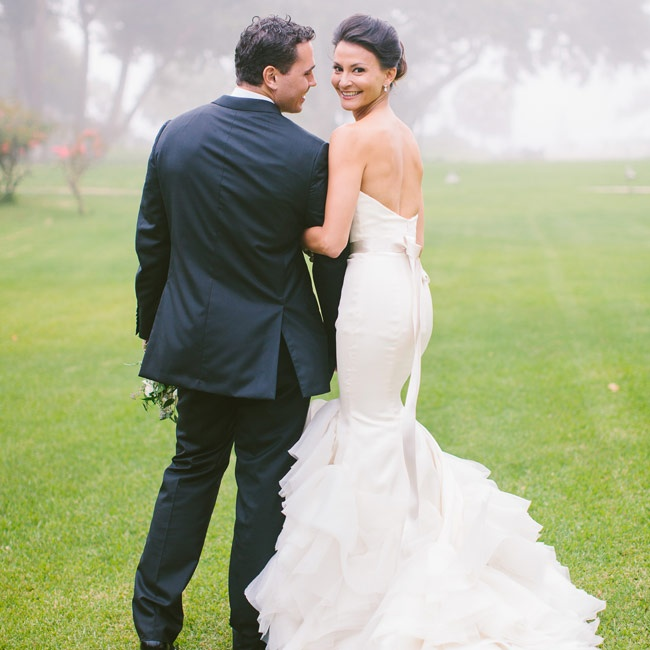 Kyla chose a stunning Lazaro gown for her nuptials. The strapless gown, which featured cascading ivory organza ruffles, an elongated bodice and a chapel train exuded romance and elegance. A satin ribbon belt at the natural waist added a polished feminine touch to the gown.
