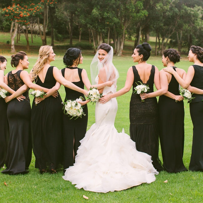 Floor-length gowns kept the bridesmaids' looks formal and elegant, while the mismatched style allowed each of the girls to show a bit of their personality.