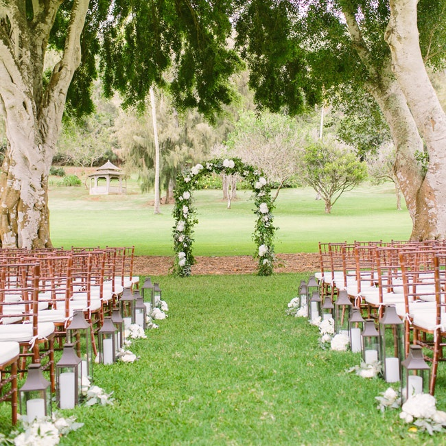 Kyla and Drew exchanged vows in an outdoor ceremony at the beautiful Four Seasons Lodge Koele under two Banyan trees. Rolling hills, lush greens and the Lodge's reflecting pond provided the perfect backdrop for the ceremony.