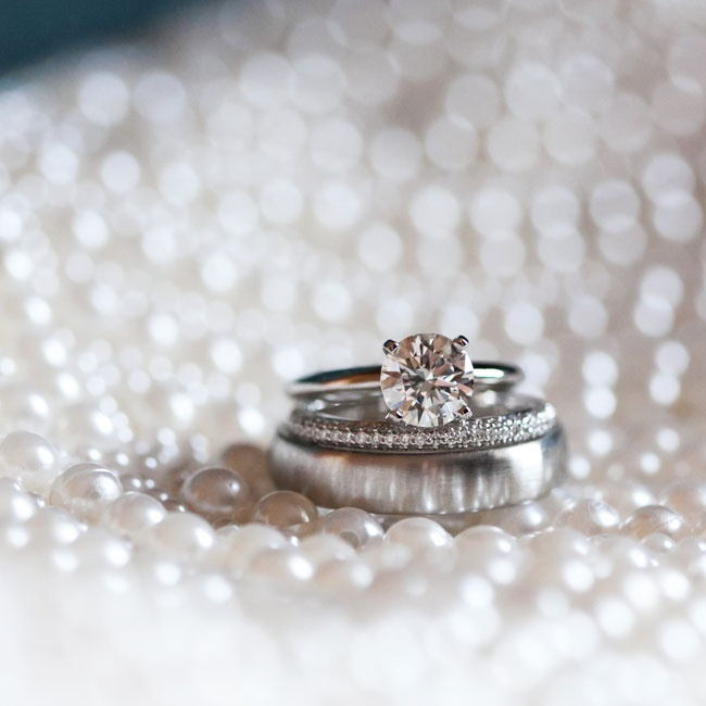Lindsay's magnificent round solitaire engagement ring from JB Hudson paired well with a simple infinity band.