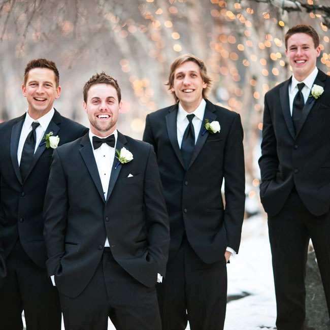 The groomsmen wore classic black tuxes to the winter wonderland wedding.
