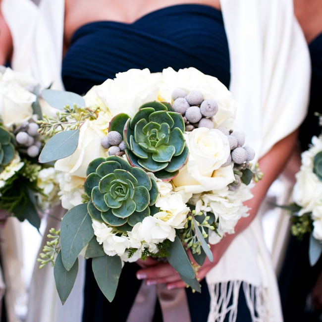 The bridesmaids carried winter bouquets of white hydrangea, silver brunia, ivory colored roses, succulents and seeded eucalyptus.