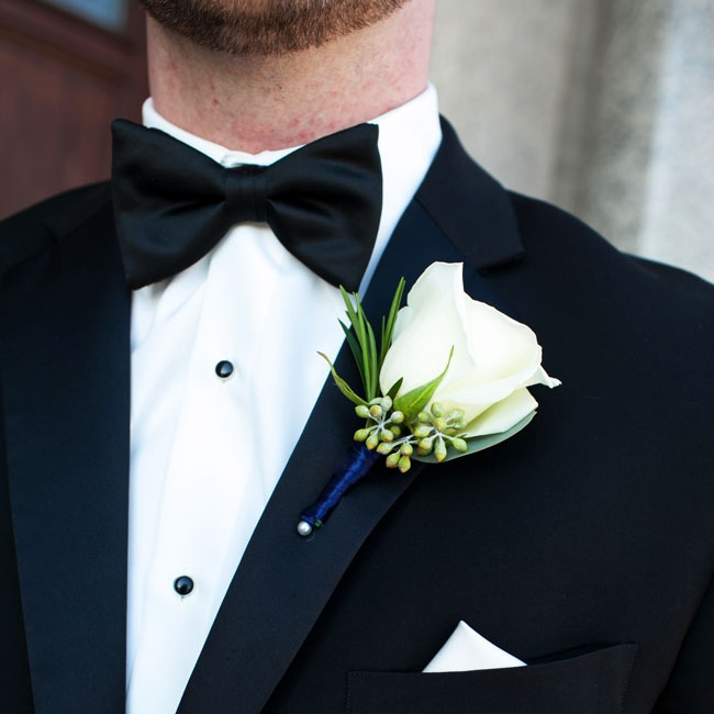 Alex added a timeless white rose boutonniere to his formal tuxedo.