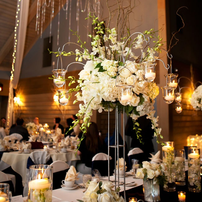 The dazzling winter reception incorporated lush winter white arrangements and endless glowing candles.