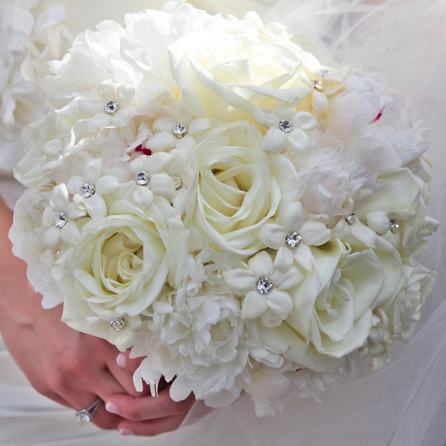 Bari carried a crystal studded bouquet of ivory roses and white peonies and stephanotis.