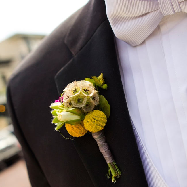 Matt's boutonniere included a unique mix of scabiosa, billy balls, and white roses.