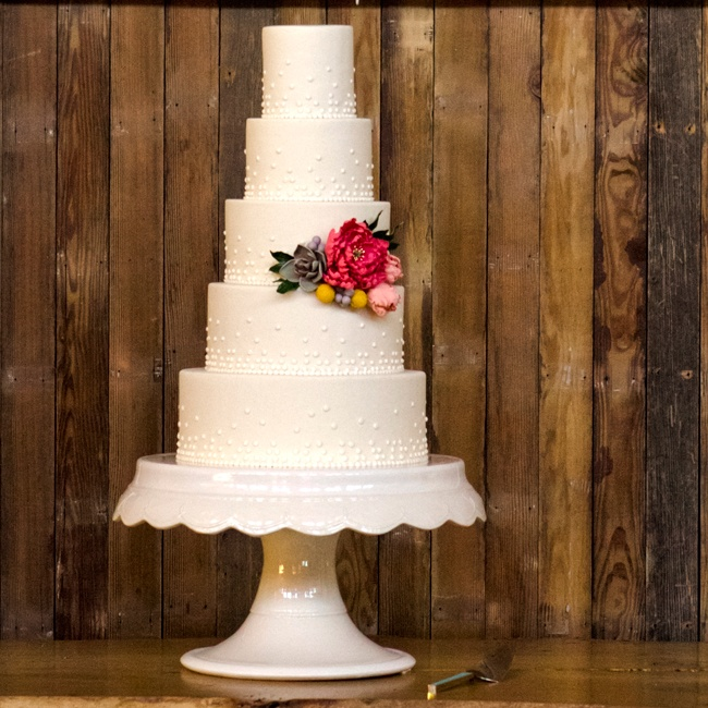 The five-tier white and pink champagne wedding cake was filled with organic berries and cream (yum!). The marzipan fondant was decorated with fondant pearls and sugar flowers that matched the bridesmaid bouquets.