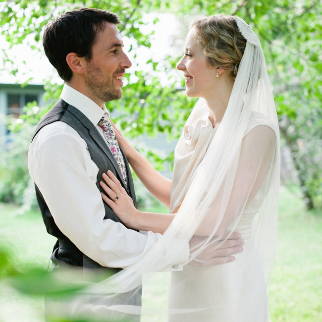 Hilary's romantic chapel length veil was made by her sister.