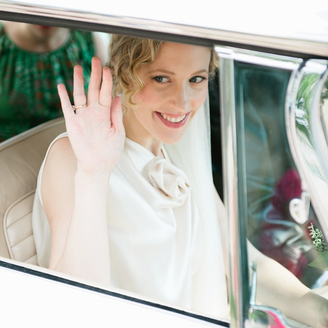 Hilary and Edward made their getaway in a white vintage car.