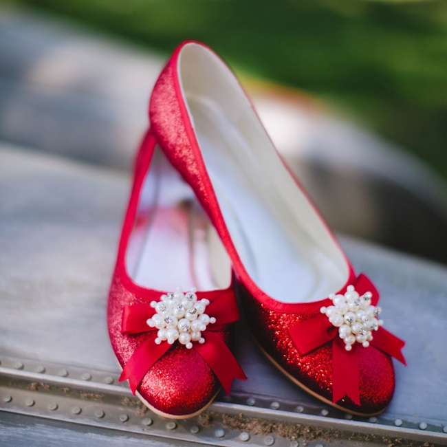 Carly's bright red shimmery shoes complemented her wedding day color palette and kept her dancing late into the night.