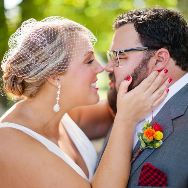 Carly put a vintage spin on her bridal look with a birdcage veil.