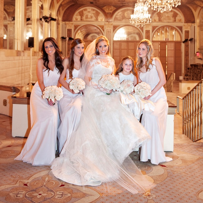 Kelley's bridesmaids matched in a feminine Ted Baker empire waist silk maxi dress with an asymmetrical one-shoulder detailing and a sweetheart neckline.