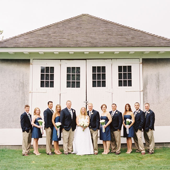 The groomsmen's navy and white ties paired well with the bridesmaids' crisp short dresses.