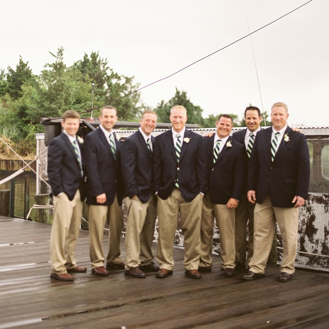 The preppy groomsmen attire included a striped tie, navy jacket, khaki pants and dark loafers.