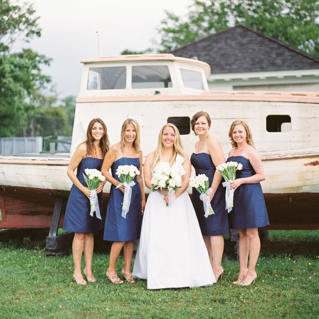 The understated bridesmaids looked timeless in strapless Alfred Sung navy dresses.