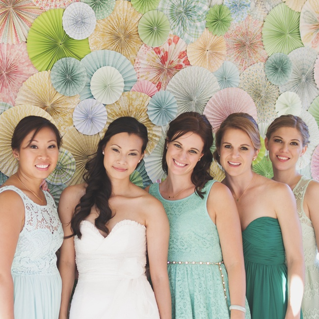 Zurry's bridesmaids wore their own dresses in different shades of green to complement the wedding's color palette.