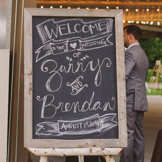 A chalkboard sign with a rustic wood frame greeted guests as they arrived.