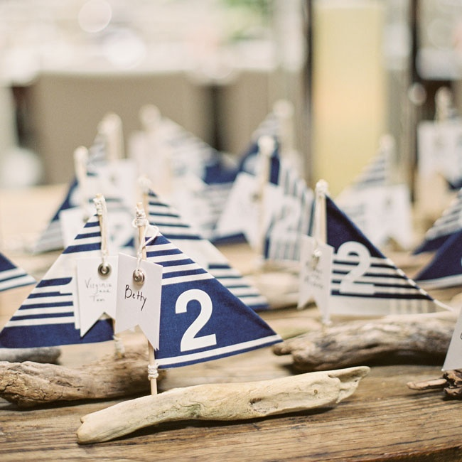 Charming striped sailboats served as playful escort cards for the nautical reception.